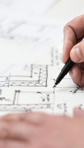 person making blue prints